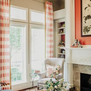 ダラスの中くらいのアジアンスタイルのおしゃれなLDK (フォーマル、ベージュの壁、濃色無垢フローリング、標準型暖炉、コンクリートの暖炉まわり、テレビなし、茶色い床) の写真