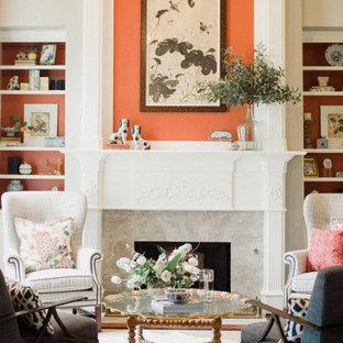 ダラスの中サイズのアジアンスタイルのおしゃれなLDK (フォーマル、ベージュの壁、濃色無垢フローリング、標準型暖炉、コンクリートの暖炉まわり、テレビなし、茶色い床) の写真