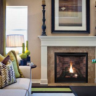 Imagen de salón para visitas abierto, clásico renovado, de tamaño medio, sin televisor, con paredes marrones, suelo de madera oscura, chimenea tradicional, marco de chimenea de baldosas y/o azulejos y suelo marrón