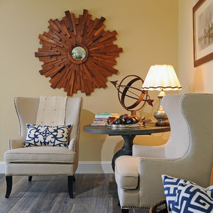 Example of a classic dark wood floor living room design in Los Angeles with yellow walls