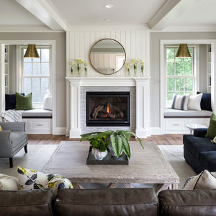 Elegant formal medium tone wood floor living room photo in Minneapolis with gray walls, a standard fireplace, a tile fireplace and no tv