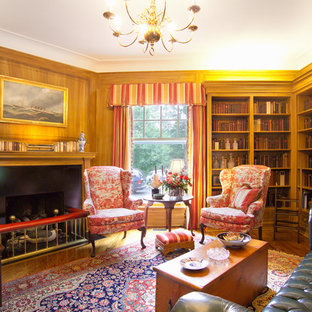This is an example of a traditional living room in Louisville with a library.