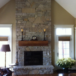 Traditional Fireplace 1 - This fireplace in Barrington, IL was completed in the Winter of 2011.  Northwest Metalcraft installed Old World stone by Natural Stone Veneers from floor to ceiling.  The rustic mantel was made by Wendt Wood Working.
