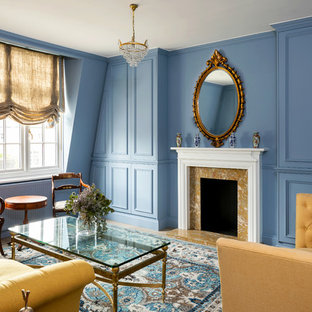 This is an example of a medium sized classic formal enclosed living room in London with blue walls, a standard fireplace, a stone fireplace surround and a concealed tv.