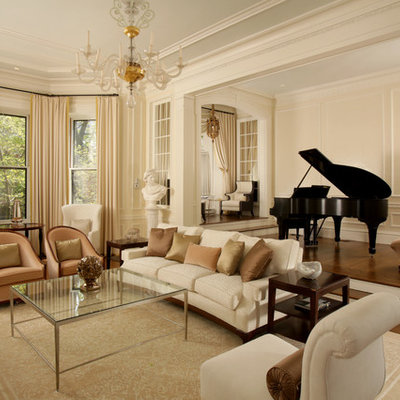 Living room - traditional formal and enclosed medium tone wood floor living room idea in Boston with beige walls