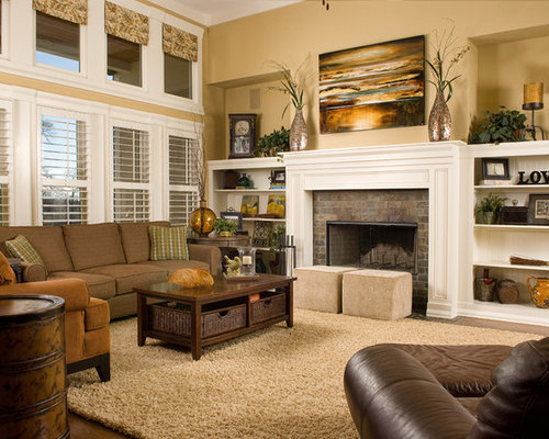 Example Of A Classic Living Room Design In DC Metro With Beige Walls