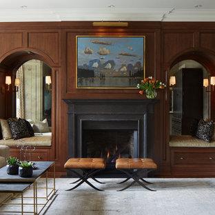 Immagine di un soggiorno chic di medie dimensioni con TV nascosta