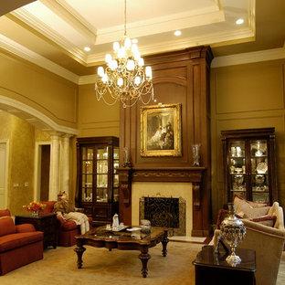 デトロイトの大きいトラディショナルスタイルのおしゃれな独立型リビング (フォーマル、ベージュの壁、濃色無垢フローリング、標準型暖炉、テレビなし、木材の暖炉まわり、茶色い床) の写真