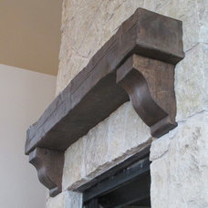 Traditional Fireplaces by Green Valley Beam & Truss Co.
