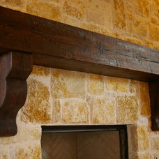 Mediterranean Fireplaces by Green Valley Beam & Truss Co.