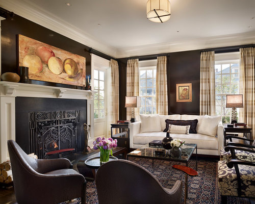 elegant formal living room photo in new york with brown walls and a standard fireplace
