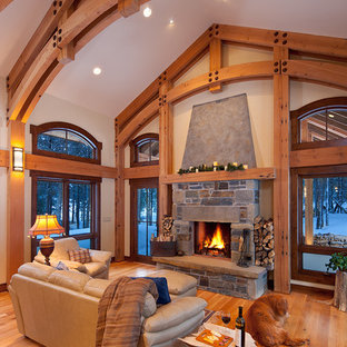 Inspiration for a traditional living room in Other with beige walls, a standard fireplace and a stone fireplace surround.