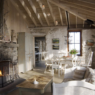 Farmhouse concrete floor living room photo in Portland Maine with a stone fireplace