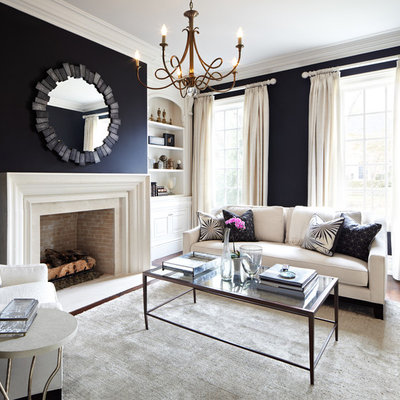 Living room - traditional formal and enclosed living room idea in Dallas with black walls, a standard fireplace and no tv