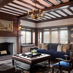 Large classic formal enclosed living room in Chicago with a standard fireplace, a concrete fireplace surround, beige walls, medium hardwood flooring and no tv.