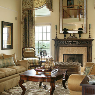 Large elegant formal and open concept medium tone wood floor living room photo in Other with white walls, a standard fireplace, a wood fireplace surround and no tv