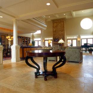 Idee per un ampio soggiorno tradizionale aperto con pavimento in marmo, sala della musica, pareti beige, camino classico, cornice del camino in pietra e nessuna TV