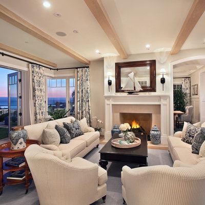 Inspiration for a timeless enclosed living room remodel in Orange County with a standard fireplace