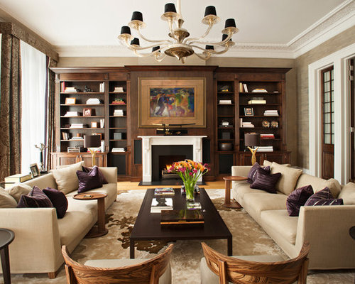 Traditional formal living room idea in London with beige walls and a  standard fireplace