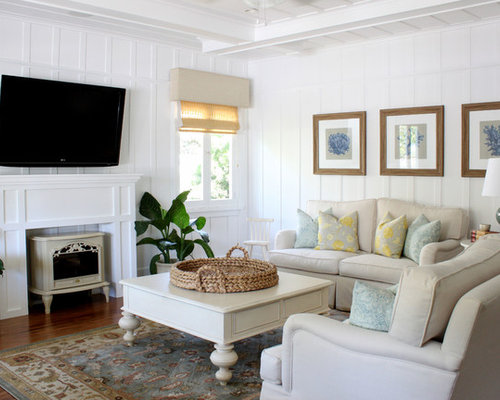Traditional Living Room Idea In Orange County With White Walls A Wall Mounted Tv