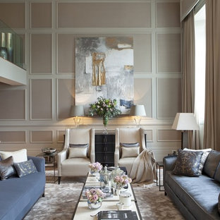Example of a classic formal medium tone wood floor living room design in London with beige walls