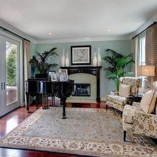Example of a classic living room design in Other with a tile fireplace