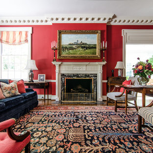 Inspiration for a traditional living room in Atlanta with red walls.