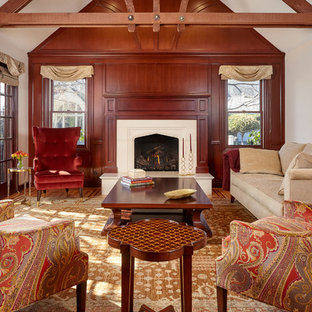 Photo of a mid-sized traditional formal enclosed living room in San Francisco with a standard fireplace, a plaster fireplace surround, no tv, beige walls, medium hardwood floors and brown floor.
