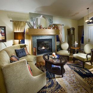 Idées déco pour un salon éclectique de taille moyenne et ouvert avec un manteau de cheminée en carrelage, un mur beige, un sol en bambou, une cheminée standard et aucun téléviseur.