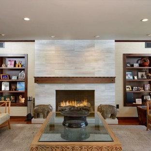 フェニックスの大きいサンタフェスタイルのおしゃれなLDK (フォーマル、無垢フローリング、標準型暖炉、石材の暖炉まわり、テレビなし、茶色い床、マルチカラーの壁) の写真
