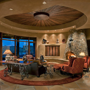 Example of a large southwest enclosed and formal living room design in Phoenix with beige walls, a stone fireplace, a corner fireplace and a concealed tv