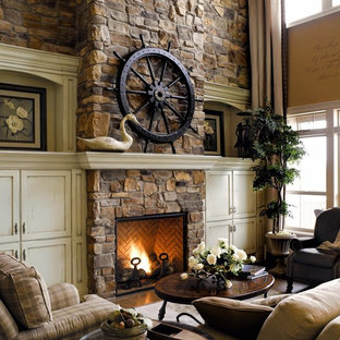 Inspiration for a beach style living room in San Diego with beige walls, a standard fireplace, a stone fireplace surround and no tv.