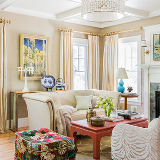 Example of a large classic enclosed and formal medium tone wood floor and brown floor living room design in Boston with beige walls, a standard fireplace and no tv