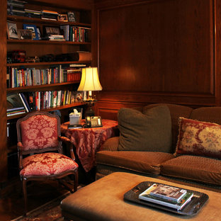 Medium sized classic enclosed living room in New York with a reading nook, brown walls and dark hardwood flooring.