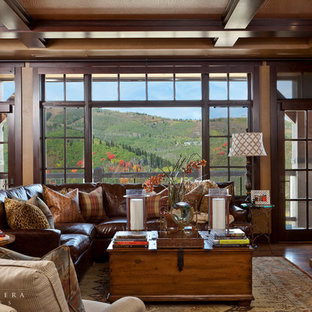 Inspiration for a transitional formal and open concept medium tone wood floor living room remodel in Orange County with a standard fireplace, a stone fireplace and a wall-mounted tv