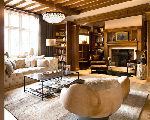 Example Of A Transitional Living Room Design In London With Library