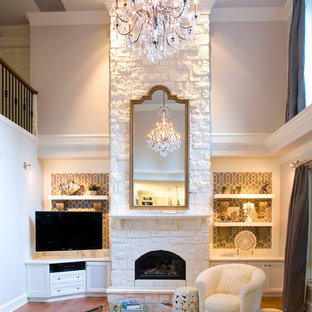 Inspiration for a transitional open concept medium tone wood floor living room remodel in Vancouver with beige walls, a standard fireplace and a stone fireplace