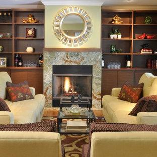 ニューヨークの大きいトランジショナルスタイルのおしゃれな独立型リビング (緑の壁、竹フローリング、フォーマル、標準型暖炉、テレビなし、石材の暖炉まわり、茶色い床) の写真