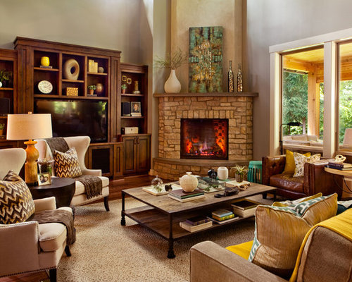 Example Of A Transitional Living Room Design In Portland With A Corner  Fireplace