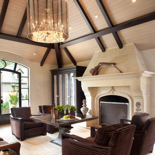 Living room - transitional medium tone wood floor living room idea in San Francisco with beige walls and a standard fireplace