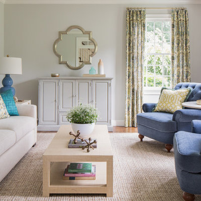 Example of a transitional formal medium tone wood floor living room design in Boston with beige walls