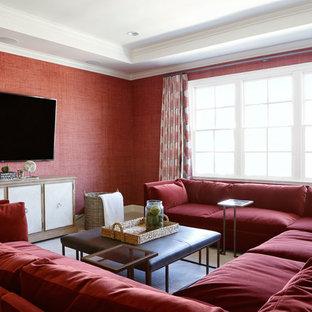 Immagine di un soggiorno tradizionale con pareti rosse, nessun camino e TV a parete