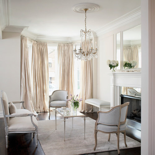 example of a formal enclosed living room design in chicago with white walls dark - Silk Drapes
