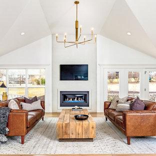 カンザスシティの大きいトランジショナルスタイルのおしゃれなLDK (白い壁、淡色無垢フローリング、コンクリートの暖炉まわり、標準型暖炉、壁掛け型テレビ、ベージュの床) の写真