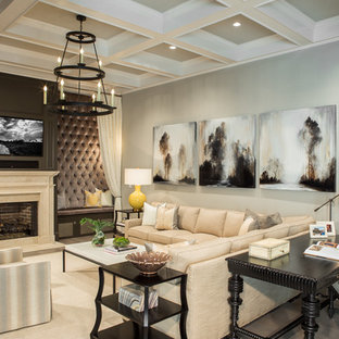 Inspiration for a large transitional open concept light wood floor living room remodel in Atlanta with gray walls, a standard fireplace and a media wall