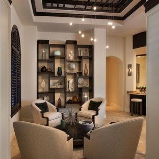 Réalisation d'un salon tradition ouvert et de taille moyenne avec une salle de réception, aucune cheminée et un sol en calcaire.