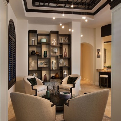 Mid-sized transitional formal and open concept limestone floor living room photo in Miami with no fireplace