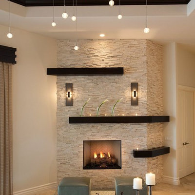 Living room - mid-sized transitional open concept limestone floor living room idea in Miami with beige walls, a standard fireplace and a stone fireplace