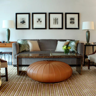 Example of a transitional living room design in Chicago with white walls