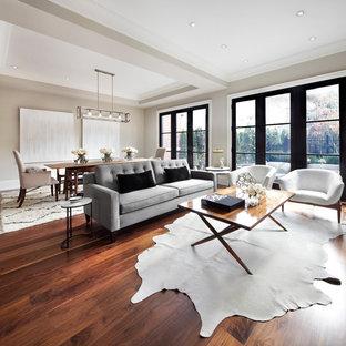 Idées déco pour un salon classique avec un mur gris.